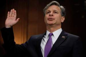 FILE PHOTO: Christopher Wray is sworn in prior to testifying before a Senate Judiciary Committee confirmation hearing on his nomination to be the next FBI director on Capitol Hill in Washington, US, July 12, 2017. Credit: Reuters/Carlos Barria