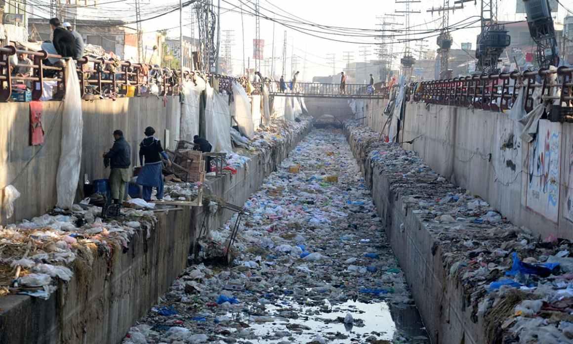 A garbage-strewn canal in Board Bazaar, Peshawar   Shahbaz Butt, White Star