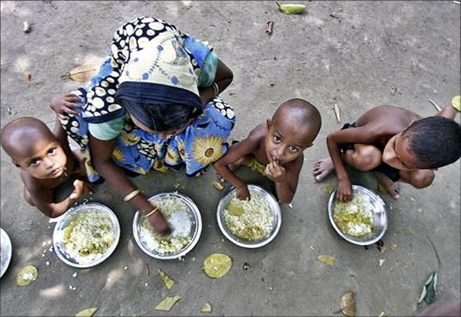Under the National Food Security Act, children between the ages of three and six are provided with hot cooked meals at anganwadi centres. Representative image credit: Reuters