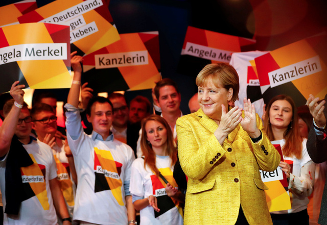 German Chancellor Angela Merkel attends a breakfast with supporters at the Christian Democratic Union (CDU) party election campaign meeting centre in Berlin, Germany, September 23, 2017. Credit: Reuters/Fabrizio Bensch