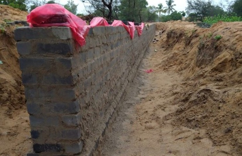 The wall that the Odisha government is building around a 1,700 hectare piece of land on Nuagaon village's periphery to mark the inclusion of the land in the state government's land bank, thereby restricting locals' access to an area where they have traditionally harvested betel leaves, rice and fish. In July 2017, villagers filed a petition against the wall's construction; this picture was filed as part of the petition.