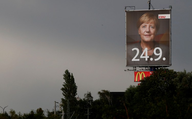 An election campaign poster for the upcoming general elections of the Christian Democratic Union party (CDU) with a head shot of German Chancellor Angela Merkel is pictured near Magdeburg, Germany, September 9, 2017. Credit:Reuters