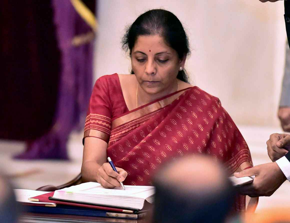 Nirmala Sitharaman signing the register after taking oath as a cabinet minister at Rashtrapati Bhavan in New Delhi on Sunday. Credit: PTI/Kamal Kishore