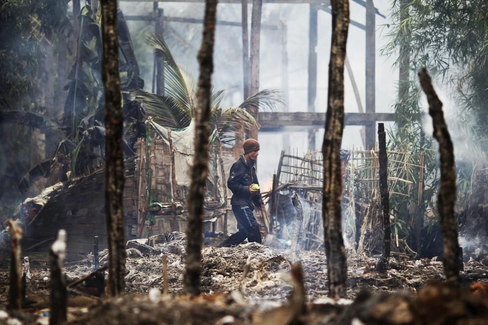 A man walks though a burnt Rohingya village during fighting between Buddhist Rakhine and Muslim Rohingya communities in Sittwe June 10, 2012. Credit: Reuters/Staff