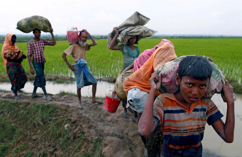 Rohingya refugees walk on a muddy path after crossing the Bangladesh-Myanmar border, in Teknaf, Bangladesh, September 6, 2017. Credit: Reuters/Danish Siddiqui/File photo