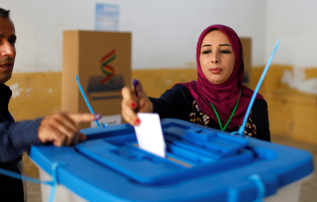 A woman casts her vote during Kurds independence referendum in Erbil, Iraq September 25, 2017. Credit: Reuters