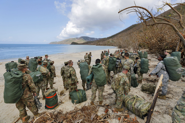 Army soldiers from the 602nd Area Support Medical Company gather on a beach as they await transport on a Navy landing craft while evacuating in advance of Hurricane Maria, in Charlotte Amalie, St. Thomas, U.S. Virgin Islands September 17, 2017. Credit: Reuters