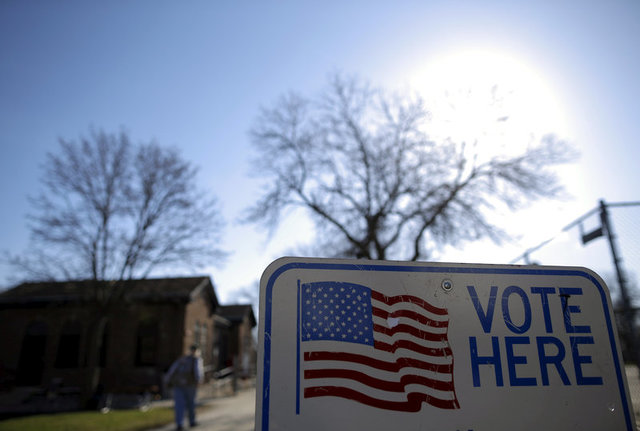A voter arrives to cast their ballot in the Wisconsin presidential primary election at a voting station in Milwaukee, Wisconsin, U.S. on April 5, 2016. Credit: Reuters