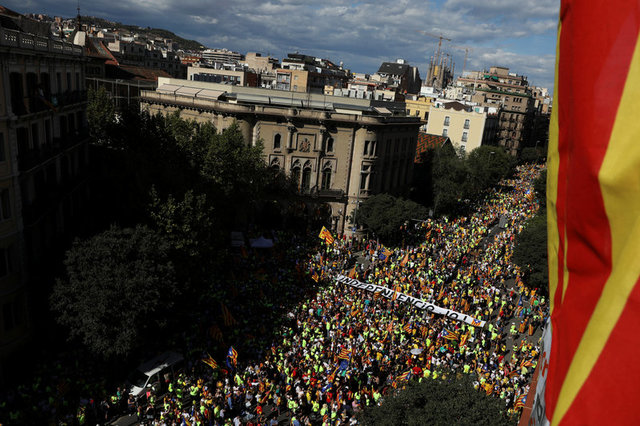 "A banner reading ""Independence Now"" is carried as thousands of people gather for a rally on Catalonia's national day 'La Diada' in Barcelona, Spain, September 11, 2017. Credit: Reuters"