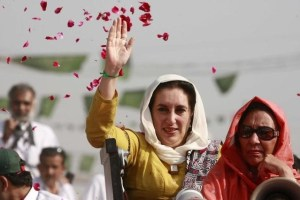 Pakistan's former prime minister Benazir Bhutto waves to supporters on her way to Shahdad Kot, where she was going to submit her nomination papers for national assembly to the district session court judge, some 515 km (320 miles) north of Karachi November 26, 2007. Credit:Reuters