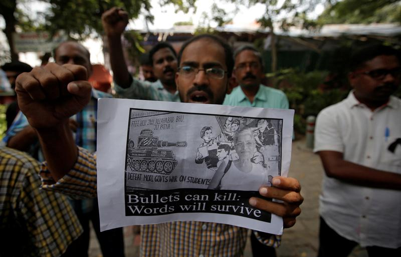 A protester displays a placard during a protest rally against the killing of Gauri Lankesh, an Indian journalist, in New Delhi, India, September 6, 2017. Credit: Reuters/Adnan Abidi