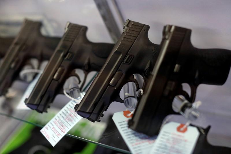 Handguns are seen for sale in a display case at Metro Shooting Supplies in Bridgeton, Missouri, November 13, 2014. Credit: Reuters
