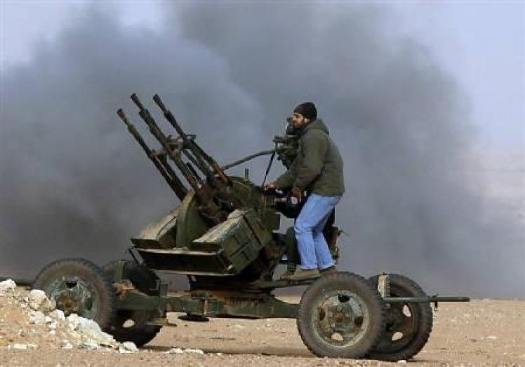 Rebel fighters return fire during shelling by soldiers loyal to Libyan leader Muammar Gaddafi in an altercation. Credit: Reuters