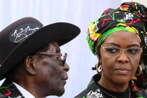 Happy at the helm: Robert and Grace Mugabe. Credit: Reuters