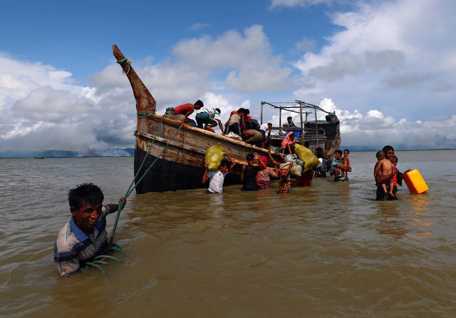 Rohingya refugees get off a boat after crossing the Bangladesh-Myanmar border through the Bay of Bengal in Shah Porir Dwip, Bangladesh September 11, 2017. Credit: Reuters