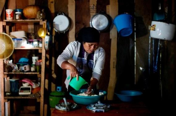 Karima Gomez, 66, a Muslim from the Tzotzil Maya ethnic group, cooks tortillas inside her house in San Cristobal de las Casas, in Chiapas state, Mexico, August 12, 2017. Credit: Reuters/Edgard Garrido/Files