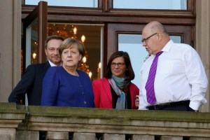 Chairman of the Free Democratic Party (FDP) Christian Lindner, leader of the Christian Democratic Union of Germany (CDU) Angela Merkel, leader of the German Green Party Katrin Goering-Eckardt and Chief of Staff of the German Chancellery Peter Altmaier are seen on a balcony of German Parliamentary Society offices during the exploratory talks about forming a new coalition government held by CDU/CSU in Berlin, Germany, October 30, 2017. Credit: Reuters/Axel Schmidt