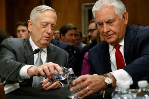 US Defense SecretaryJames Mattis pours a glass of water for Secretary of State Rex Tillerson as they arrive to testify about authorizations for the use of military force before the Senate Foreign Relations Committee on Capitol Hill in Washington, US October 30, 2017. Credit: Reuters/Jonathan Ernst