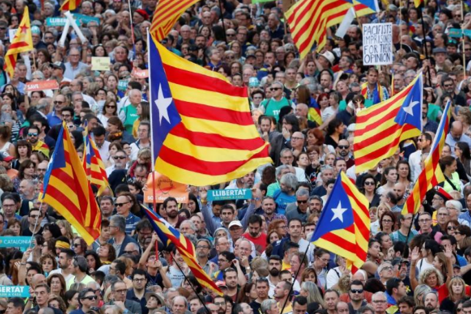People wave Catalan separatist flags during a demonstration organised by Catalan pro-independence movements ANC (Catalan National Assembly) and Omnium Cutural, following the imprisonment of their two leaders Jordi Sanchez and Jordi Cuixart, in Barcelona, Spain, October 21, 2017