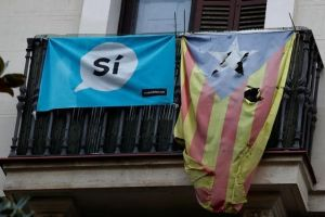 A damaged Estelada (Catalan flag of independence) hangs from a balcony in Barcelona, Spain, October 20, 2017. Credit: Reuters