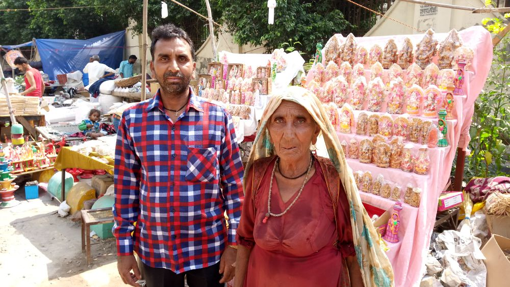 Kaushalya Devi, who has been selling earthenware, for the last 40 years says she has never seen such low sales in her life. Here she is seen with son Satpal at their shop.