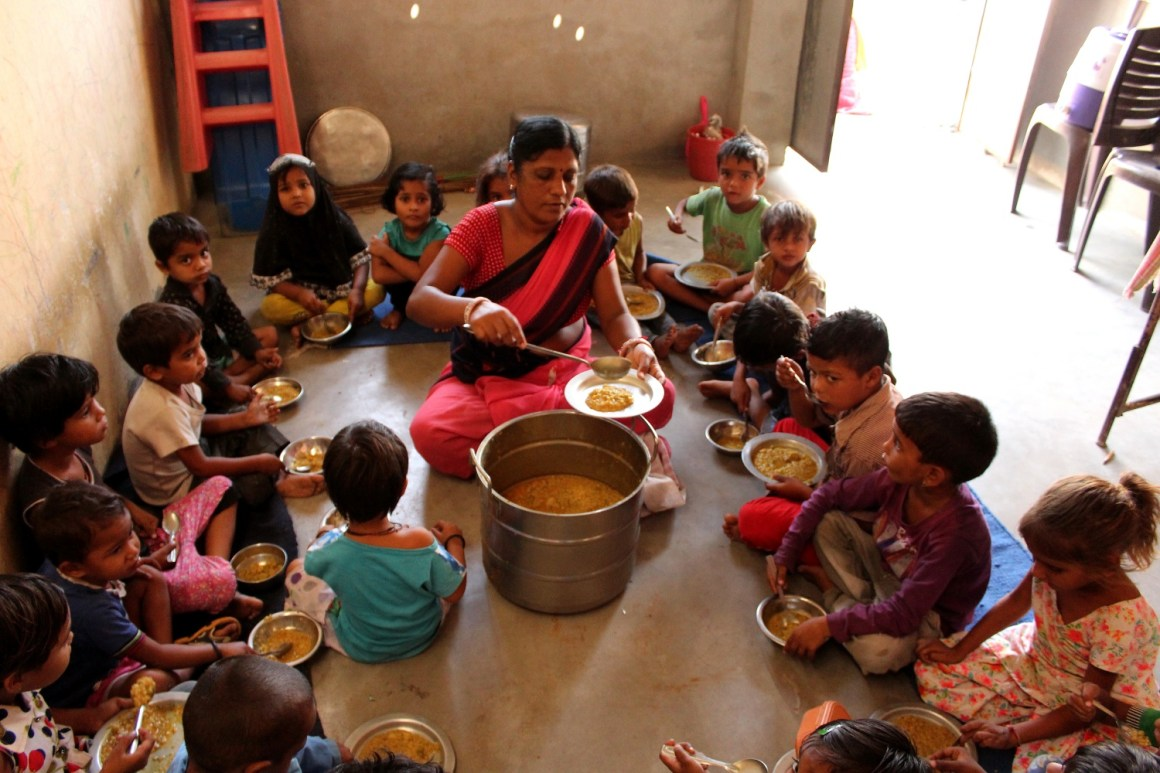 Kids consuming the hot cooked meal at an anganwadi centre in Jaipur