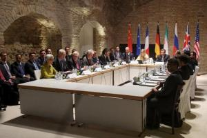 Negotiators of Iran and six world powers face each other at a table in the historic basement of Palais Coburg hotel in Vienna April 24, 2015. Credit: Reuters