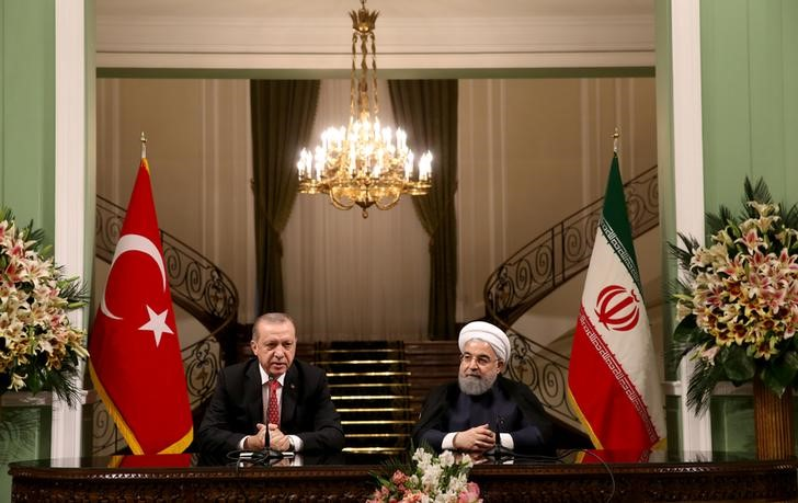 Turkish President Tayyip Erdogan is seen with his Iranian counterpart Hassan Rouhani during a joint news conference in Tehran, Iran, October 4, 2017. Credit: Murat Cetinmuhurdar/Presidential Palace/Handout via Reuters