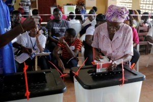 A woman casts her ballot during presidential elections at a polling station in Monrovia, Liberia, October 10, 2017. Credit: Reuters