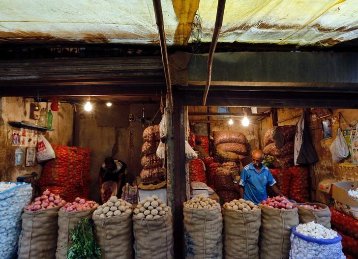 Vendors wait for customers at vegetable stalls at a wholesale fruit and vegetable market in Mumbai, India, June 14, 2017. Credit: Reuters/Danish Siddiqui/Files