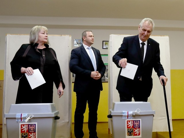 Czech President Milos Zeman and his wife Ivana cast their votes in parliamentary elections at a polling station in Prague, Czech Republic October 20, 2017. Credit: Reuters