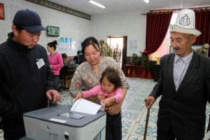 People vote at a polling station during the presidential election in the village of Kyzyl-Birdik, Kyrgyzstan October 15, 2017