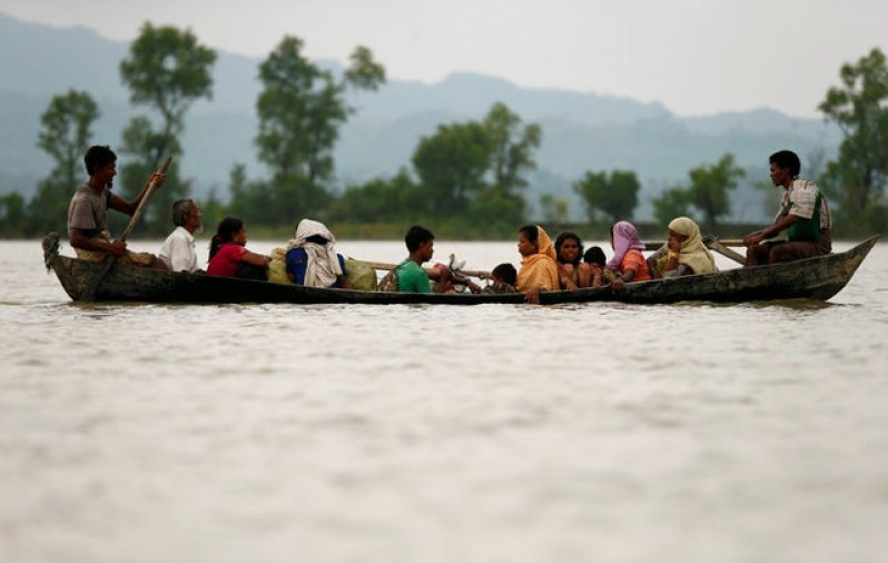 Rohingya refugees are seen on a boat as they are crossing border through the Naf river in Teknaf, Bangladesh, September 7, 2017. Credit: Reuters