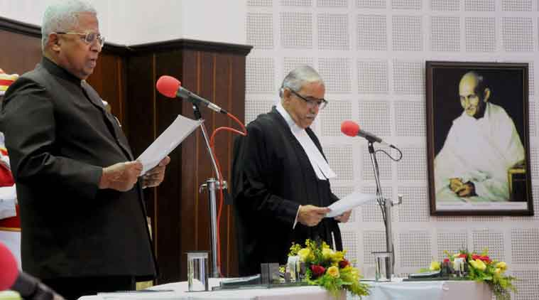 Tathgata Roy (L) being sworn in as governor of Tripura in 2015. Credit: PTI/Files