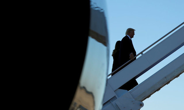 U.S. President Donald Trump and first lady Melania Trump board Air Force One as they depart Joint Base Andrews in Maryland, U.S., on their way to Las Vegas, October 4, 2017. Credit: Reuters