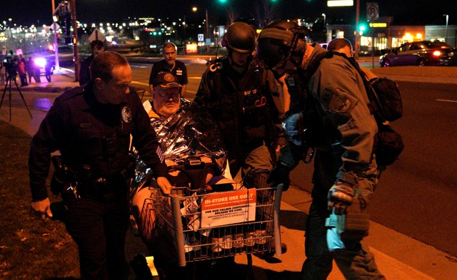 Patrick Carnes is evacuated in a Walmart cart by SWAT medics from the scene of a shooting at a Walmart where Carnes was shopping in Thornton, Colorado November 1, 2017. Credit: Reuters/Rick Wilking