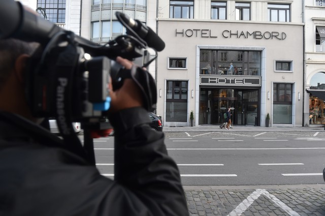 A cameraman waits outside a hotel where sacked Catalonian President Carles Puigdemont is thought to be staying in Brussels, Belgium, November 1, 2017. Credit: Reuters/Eric Vidal