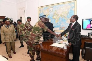 President Robert Mugabe meets with senior members of the Zimbabwe Defence Forces and police at State House in Harare, Zimbabwe November 19, 2017. ZIMPAPERS/Joseph Nyadzayo/Handout via Reuters
