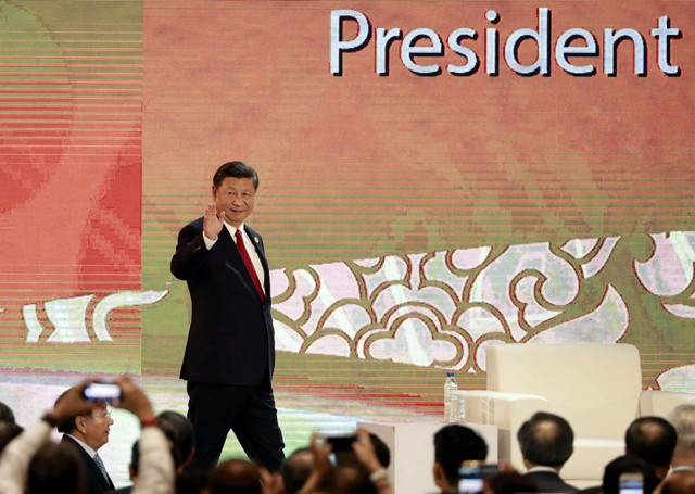 China's President Xi Jinping arrives to speak on the final day of the APEC CEO Summit ahead of the Asia-Pacific Economic Cooperation (APEC) leaders summit in Danang, Vietnam, November 10, 2017. Credit: Reuters/Nyein Chan Naing/Pool