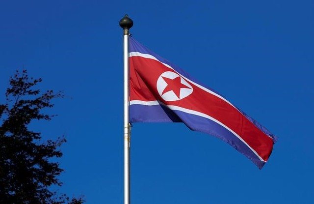 FILE PHOTO - A North Korean flag flies on a mast at the Permanent Mission of North Korea in Geneva October 2, 2014. Credit: Reuters/Denis Balibouse/File Photo