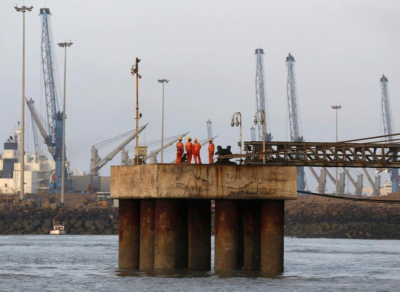 Workers wait for a cargo ship to beach at Mundra Port in Gujarat April 2, 2014. Credit: Reuters/Amit Dave