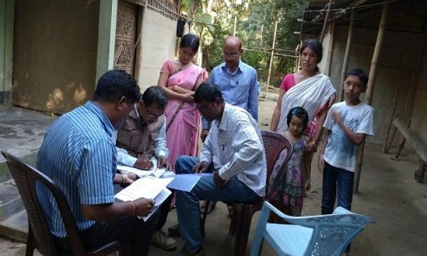 NRC officials verifying documents in Morigaon, Assam. Credit: Sangeeta Barooah Pisharoty.