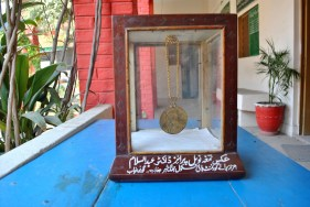 Replica of Abdus Salam's Nobel Prize at his school. Credit: Aown Ali