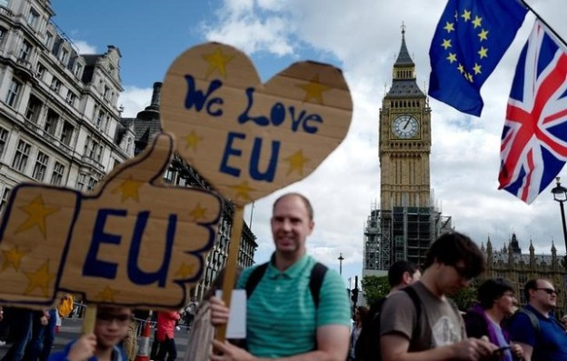 Demonstrators stand in Parliament Square during the anti-Brexit 'People's March for Europe', in central London, Britain September 9, 2017. Credit: Reuters/Tolga Akmen/Files