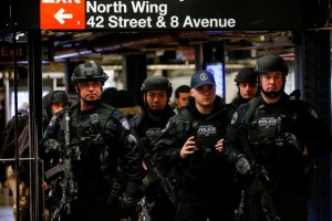 Members of the Port Authority Police Counter Terrorism unit patrol the subway corridor, at the New York Port Authority subway station near the site of an attempted detonation the day before, during the morning rush in New York City, U.S. December 12, 2017. Credit: Reuters/Brendan McDermid