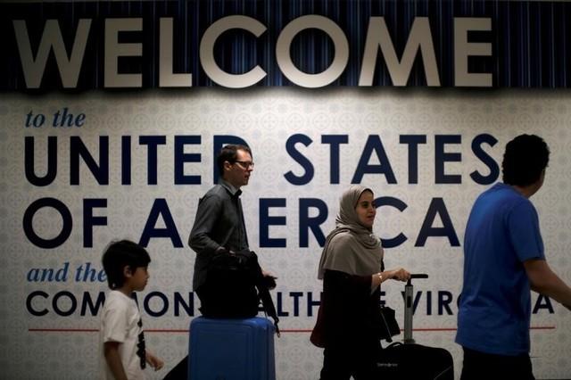 International passengers arrive at Washington Dulles International Airport, in Dulles, Virginia, U.S., June 26, 2017. Credit: Reuters/James Lawler Duggan