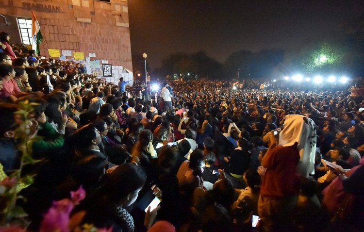 New Delhi: JNUSU President Kanhaiya Kumar addresses students after reaching at the JNU campus upon his release on bail, in New Delhi on Thursday. PTI Photo by Vijay Verma (PTI3_3_2016_000232B)