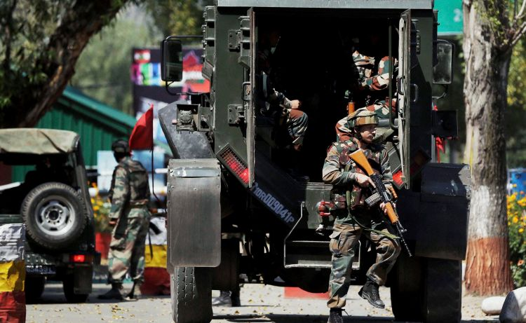 Uri: Army personnel in action inside the Army Brigade camp during a terror attack in Uri, Jammu and Kashmir on Sunday. PTI Photo(PTI9_18_2016_000154B)