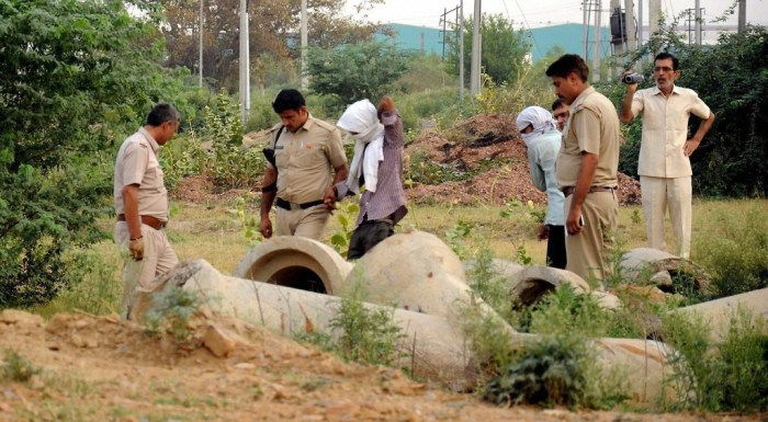 Rohtak: Police, with the accused, inspecting the scene of crime where the brutally mutilated body of a woman was dumped after she was abducted, gang-raped and murdered, in Rohtak on Sunday. PTI Photo  (PTI5_14_2017_000141B)