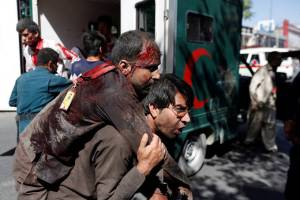 ATTENTION EDITORS - VISUAL COVERAGE OF SCENES OF INJURY OR DEATHAn Afghan man carries an injured man to a hospital after a blast in Kabul, Afghanistan May 31, 2017.  REUTERS/Mohammad Ismail